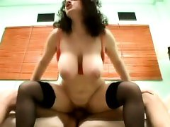 Huge breasted brunette spreads her legs and relishes a deep pounding