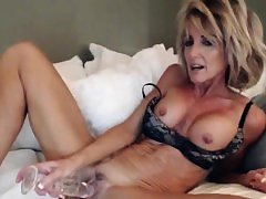 Horny milf blonde hard masturbating in bed