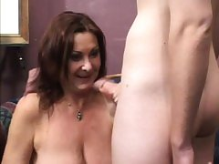 Stacked milf has a young stud's cock driving her hairy slit to climax
