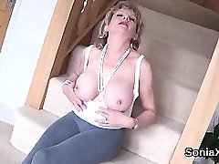 Adulterous uk mature lady sonia flashes her massive balloons