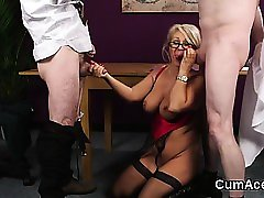 Flirty honey gets cum shot on her face eating all the cum