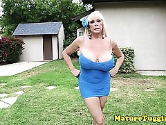 Huge titted mature lady gives titjob POV