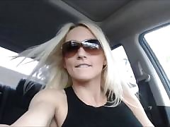 Blonde MILF babe toys her perfect twat in the car