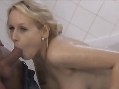 Busty blonde enjoys fucking and giving a footjob