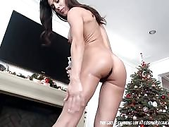Fitness MILF fucking herself infront of the christmas tree