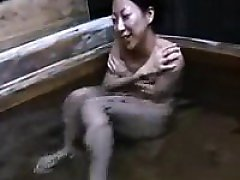 Slender Asian beauty likes being watched while taking a hot